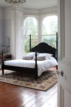 Its all about those widows that make this Pretty bed even prettier