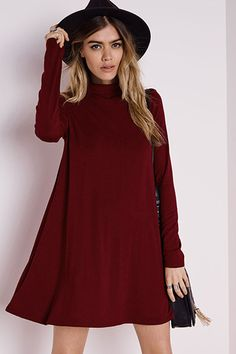 Teagan is a modern sleek turtle neck dress that can also be worn as a top.