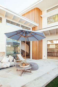 Backyard Reveal - Kyal & Kara : Kyal & Kara Stone Cladding, Timber Cladding, Large Round Ottoman, Stacker Doors, Kyal And Kara, Freedom Furniture, Timber Beams, Entry Gates, Building Design