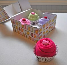 """""""Cupcake Onesies"""" for a Baby Shower Gift, or those fluffy socks rolled up to make a """"sock cupcake"""""""