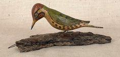 """Pook & Pook.  October 27th 2012 Lot 282.   Estimated: $400 - $600 Realized Price: $2309 Carved and painted woodpecker, late 19th c., attributed to George Miller, Upper Black Eddy, Bucks County, Pennsylvania, 5"""" h., 11 1/2"""" w."""