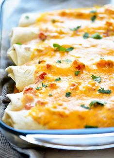 Ranch Chicken Enchiladas are flour tortillas wrapped around a shredded taco chicken center that is covered in cheese and a salsa-ranch mixture. Ranch Chicken Enchiladas, Taco Chicken, Supper Recipes, Entree Recipes, Cooking Recipes, Microwave Recipes, Crockpot Recipes, Easy Mexican Dishes, Mexican Food Recipes