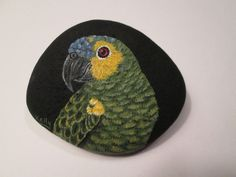 Blue+Fronted+Amazon+Parrot+Portrait+hand+painted+on+a+rock+by+Ann+Kelly+#Realism