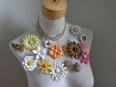 Lovely jewelry display - just afraid that the pinning and repinning might wreck the fabric on the mannequin.