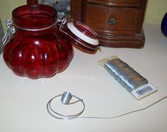Olive oil lamps made with dollar store mop strings for the wicks