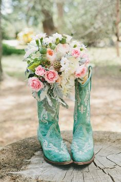 Bouquet with teal boots great photo shot/  deland fl wedding flowers 32724/ orange city fl wedding flowers/  volusia county wedding flowers/ www.callaraesfloralevents.com