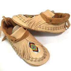 Louis Classy from the Louis Collection #moccasins #deerskin #footwear #artisan #shoes #native #plains #beadwork #womenswear #menswear #art #handmade with #love