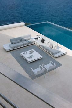 Browse swimming pool design ideas for the perfect pool for your home. Discover pool deck ideas and landscaping options to create your dream swimming pool Outdoor Spaces, Outdoor Living, Outdoor Decor, Outdoor Sofas, Outdoor Rugs, Exterior Design, Interior And Exterior, Piscina Spa, Garden Side Table