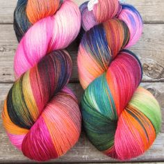 Our craziest rainbow colorway yet: hot pink, yellow, green, and blue, all with a hint of brown and natural cream. If you need more than one skein for your project, we will do our best to visually matc