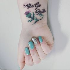Delicate Thistle Tattoo Wrist for Ladies