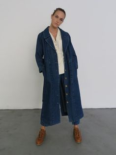 Trenchcoat in denim with notched lapel. On-seam pockets at waist. Interior strap adjustment for gathering at waist. Exaggerated back vent. Made in USA. Denim Trench Coat, Trench Coat Outfit, Long Denim Shirt, Shirt Outfit, Coats For Women, Autumn Fashion, Raincoat, Oxford, Plus Size