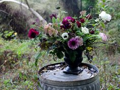 RAMBLING GARDEN ARRANGEMENT by Studio Choo:   an assortment of beautiful blooms and seasonal foliage in a black ceramic pedestal vase