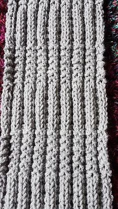 This easy 2 row, reversible, textured, design is perfect for either a scarf or cowl. It does not curl. Patterns for both are included.