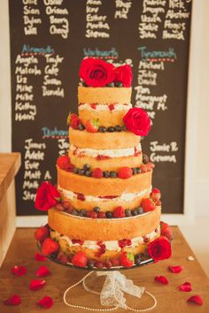 Four tier naked sponge cake decorated with fresh fruit and flowers | Photography by http://alexapenberthy.com/