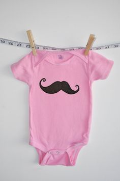 baby onesie pink with mustache. $16.00 USD, via Etsy.