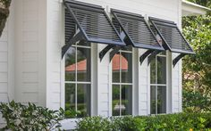 homes with bahama shutters - Google Search Got to have white Bahamian shutters on my coral colored beach house