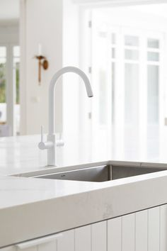 I chose matt white tapware from Caroma so that the taps didn't break up the all-white aesthetic – anything other that white was going to rain on my reno parade. I love how they blend in rather than jump out as you look across the island sink, past the ser White Kitchen Faucet, White Sink, Kitchen Sinks, Kitchen Doors, Kitchen Utensils, Kitchen Gadgets, Black Kitchens, Home Kitchens, Dream Kitchens