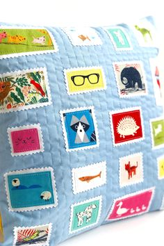 How to make an adorable postage stamp quilted pillow. A great use of fabric scraps! #quiltedpillow #fussycutfabric #fussycut #DIYpillow