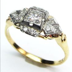 Two Tone Treat: Crisp details define the tapered, diamond sprinkled shoulders, and an exceptionally bright stone is nicely framed in the center. Ca.1935.  Maloys.com