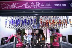 Royal Caribbean: Offering visitors a taste of the future, Royal Caribbean's Bionic Bar premiered at Italian Bites on the Beach on Friday night. The robotic bartending system, created by Makr Shakr, plucked bottles from overhead to mix drinks.