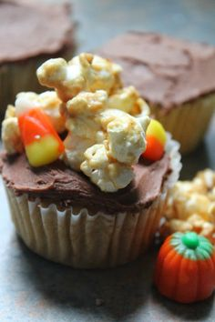 caramel cupcake with chocolate frosting and homemade caramel corn from foodie ventures