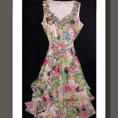 Dress Beautiful layered floral dress, with a ruffled flower neckline, and inner slip...Belt has a ruffled flower as well as shown in picture this dress is so flowy and simply gorgeous! Really nice dress for that speacial occasion ❤ 100%Polyester. Length is approximately  42in.  NWOT    Dress Barn Dresses