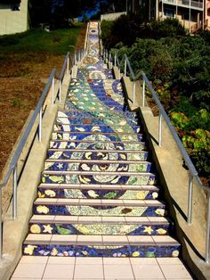 The 16th Avenue Staircase is 163 steps of mosaic tiles, a colorful staircase hidden in the quiet Sunset district of San Francisco.