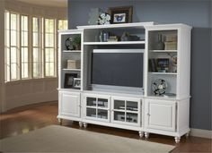 Incredible White Shelving Unit Design with Shelves and Drawers and Cabinets also TV Space Idea for Living Room