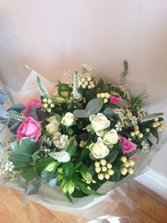 White Handtied bouquet with a touch of pink x
