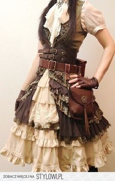 Tiered ruffled skirt with long tiered ruffled sleeveless overdress, leather packs, frilly jabot with brooch