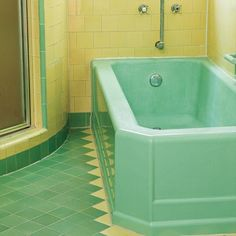 Green and yellow 1950s bathroom. Period detail with hexagonal taps with pipe work set in the wall.
