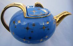 Hall tea pot gold starburst CADET BLUE Vintage Hook Lid Pottery Collectible Star. $28.00, via Etsy.