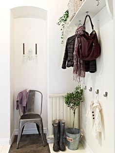 simple entry, like the hooks on the high up shelf - add space to your entry, by adding something like this?