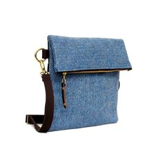A hardy and practical, messenger style shoulder bag in Blue Herringbone Harris…