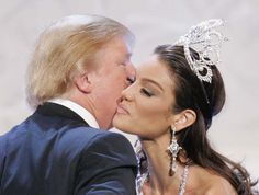 Donald Trump, left, congratulates Zuleyka Rivera Mendoza, Miss Puerto Rico 2006, after winning the Miss Universe 2006 pageant on Sunday, July 23, 2006, in Los Angeles.  (AP Photo/Mark J. Terrill)