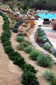 Back yard landscaping design idea with steep slope by Singing Gardens.