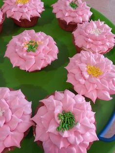Pretty pink flower cupcakes.  Yummy! Follow me on FACEBOOK Sweet Little Kakes!