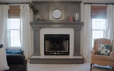 GORGEOUS Oak Fireplace Makeover - The fireplace was painted with Benjamin Moore Kendall Charcoal for trim and cabinets. The walls were painted Benjamin Moore Gray Owl with 25% more grey added. The home owners loved gray owl but wanted it a little darker. The trim is painted BM Decorators White.