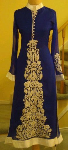 Royal blue and gold, with a collar neck and full sleeves. Will make you look like royalty.