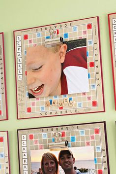 Playful display idea! Game boards create symmetrical group and large color photos create harmony. Notice the clips for hanging the photos? Great way to rotate prints as kids grow or add new theme.