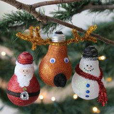 Painted and glittered and decorated light bulbs as Christmas ornaments