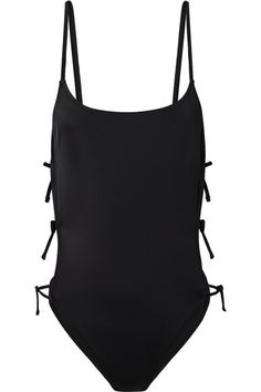Lily Aldridge and a group of 12 other models traveled to the Bahamas to shoot Solid and Striped's 'Swim Team' collection. This black swimsuit is her own design for the capsule, and has daring lace-up cutout sides. It's made from smoothing stretch fabric that feels comfortable and supportive.