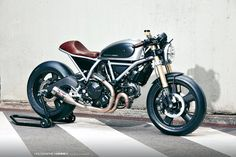 Holographic Hammer transitions from designing bikes to building them, with this slick, upgraded Ducati Scrambler-based café racer.