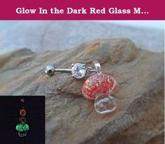 Glow In the Dark Red Glass Mushroom Belly Ring Body Jewelry 14ga. Glow in the Red Mushroom Belly ring * 316L 14ga Surgical Stainless Steel * White Rhinestone * Glow mushroom No two mushrooms are made alike! Each one may vary slightly The mushroom easily charges in the light. You can use sun light, a house light, uv light. The longer it is charged the longer the glow. The glow will last up to 12 hours and can be easily recharged.