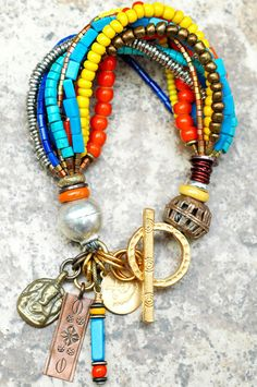 Olympian Charm Bracelet: Blue, Orange and Yellow Mixed Media Charm Bracelet $175
