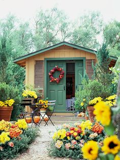 Smart Style Shed-small building offers storage and relaxing spots, too.    -- Double doors, which slide unobtrusively out of the way, save space inside the shed