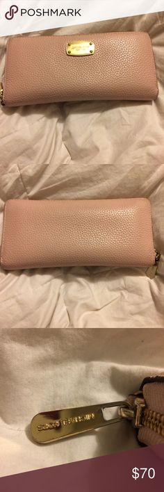 Michael Kors JetSet Continental Wristlet Soft Pink Wallet has been used but is in great condition. The only visible sign of wear is on zipper pull and a faint line on back. Inside comes with card slots, a zip pocket, and several other pockets. If you have any questions please feel free to ask Michael Kors Bags Clutches & Wristlets