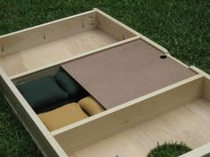 Under board cornhole bag storage.  Awesome idea!