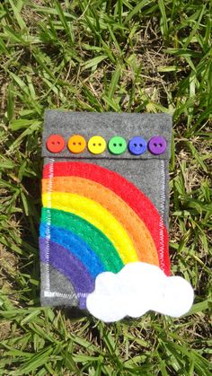 "applique felt  rainbow on a hoop with embroidered words ""somewhere over the rainbow"" cloud hanging off the edge of hoop..."