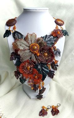 Wonderful bead embroidered jewellery by Irina Chikineva.